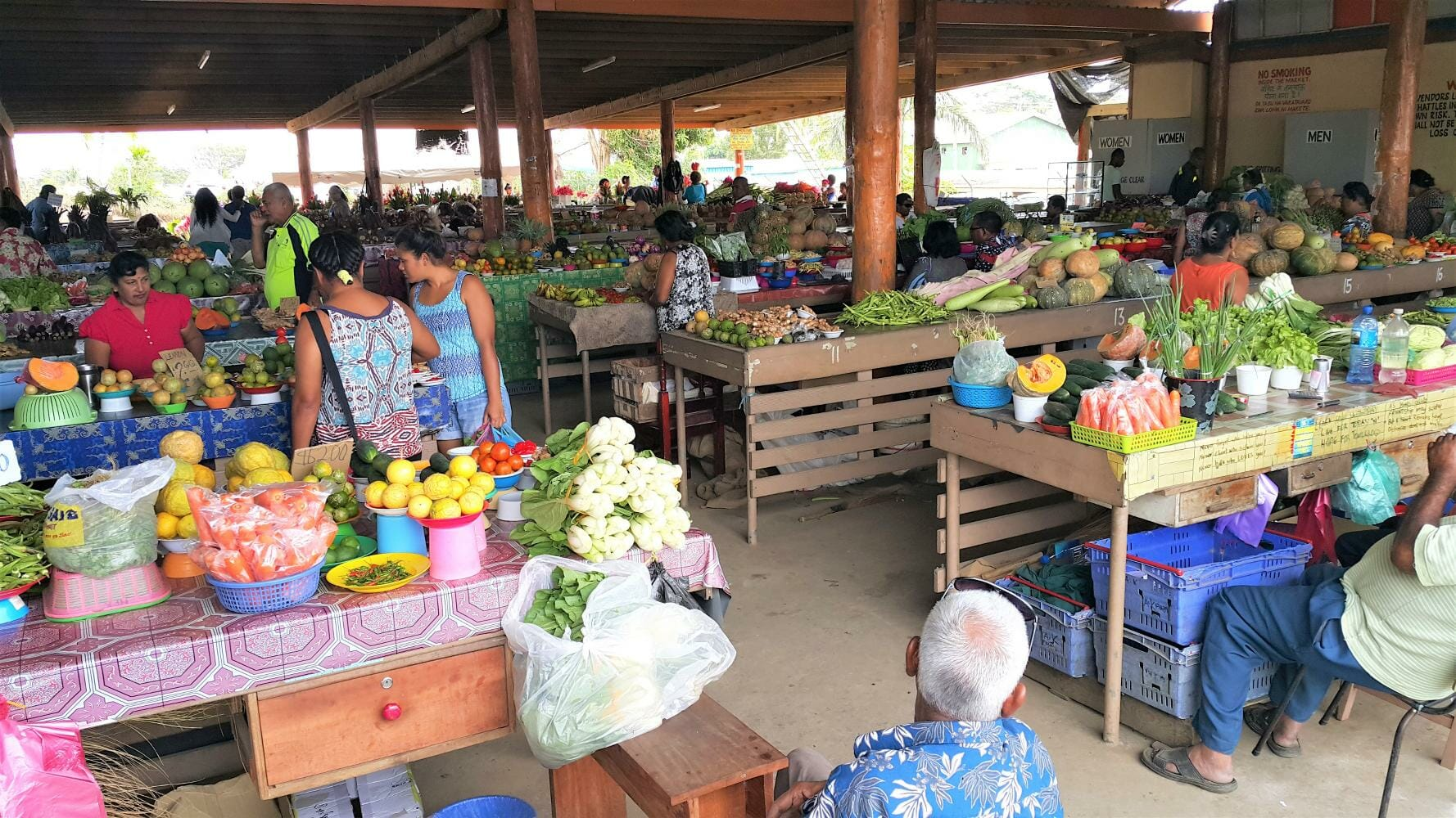 Fijian locals selling fresh fruit and veg at the local markets in Fiji