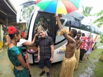 Friendly Fijian village getting off the bus on tour in Fiji