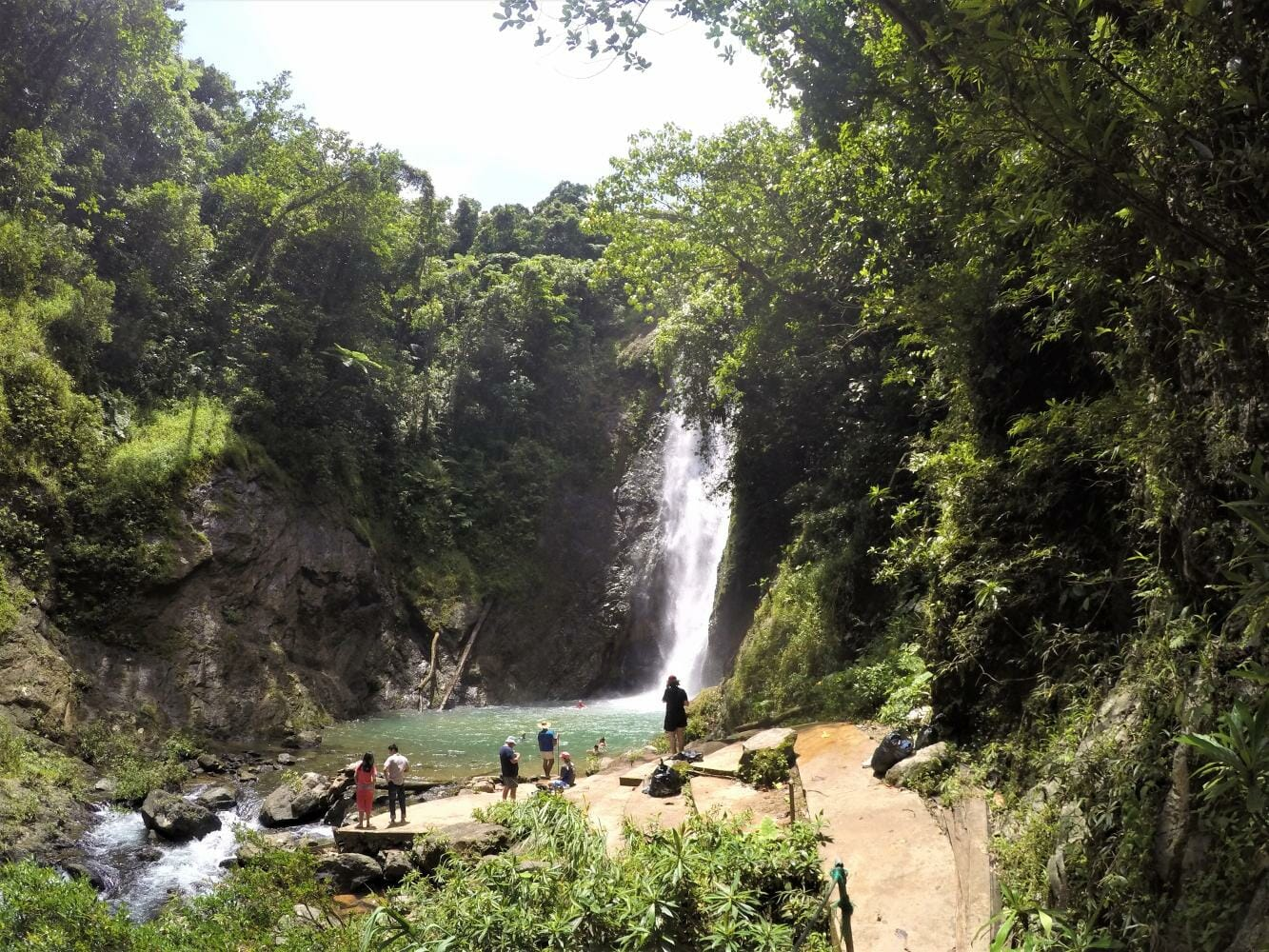 First view of the biggest waterfall on the Navua River on the Jewel of Fiji tour in Fiji