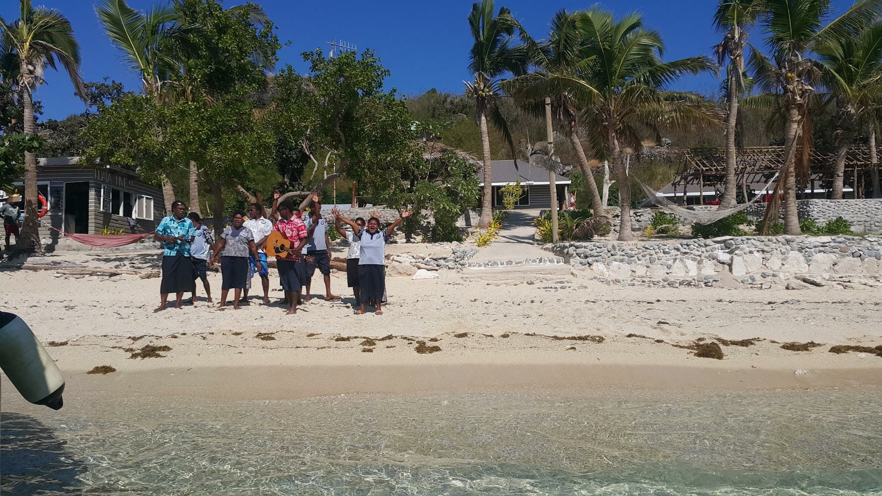 Lovely Fijian welcome as you arrive at Barefoot Kuata Island in the Yasawas in Fiji