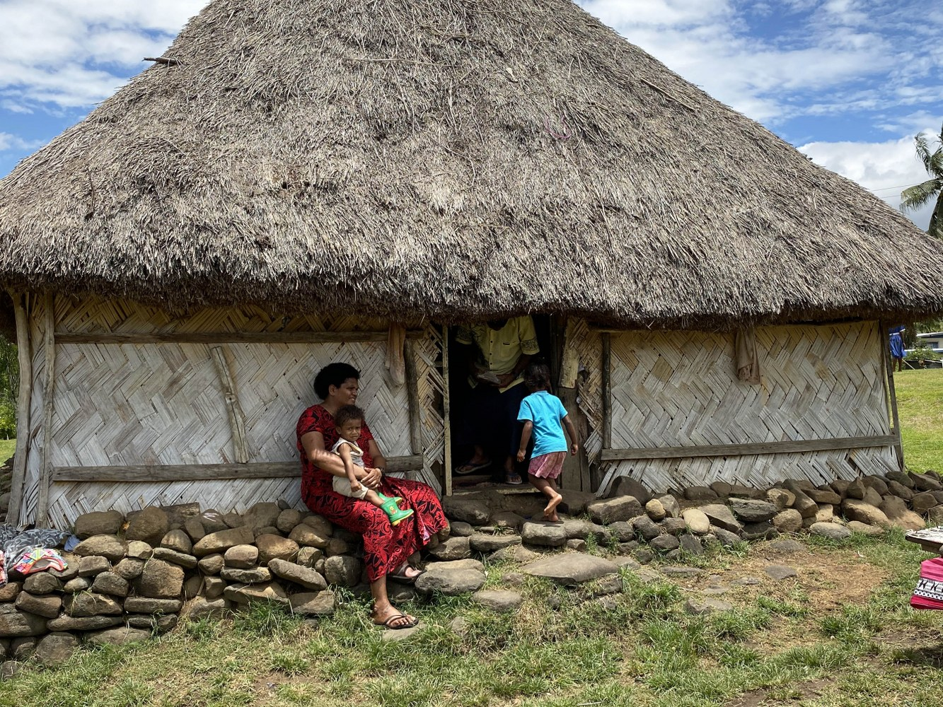 Typical Fijian family and their house living in their world of happiness