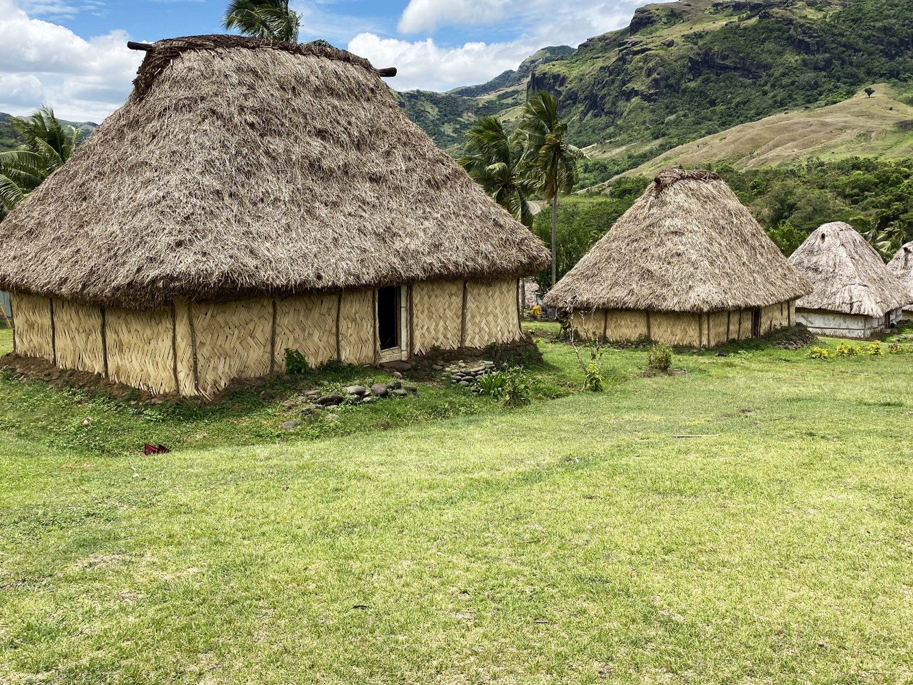 Typical Fijian neighbours with houses close to each other in the local communal area called the village