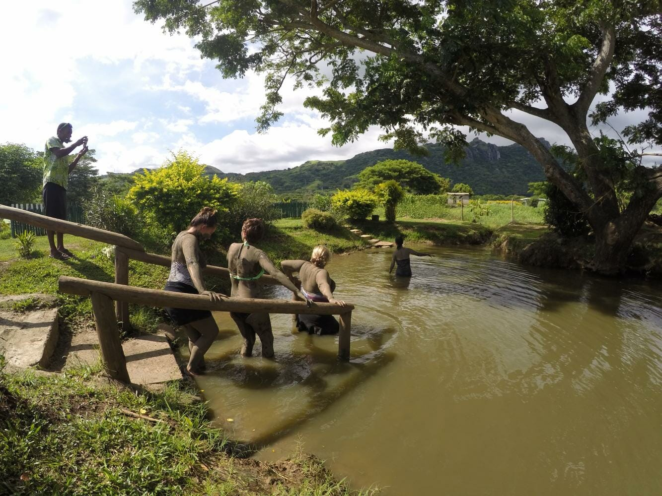 Taking a dip in the mud pools on a private tour in Fiji. One of the best things to do in Fiji